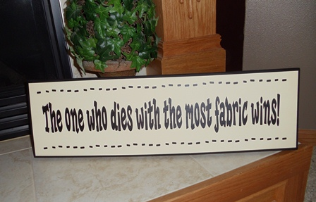 """The one with the most fabric wins"" Wood Plaque"
